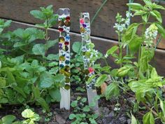Jeweled Garden Sticks: I have heard that shiny things scare the pests away from snacking in the garden. I hope that's the truth, but either way adding these beautiful shining sticks to the yard makes a beautiful addition to the garden!