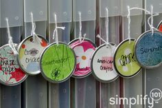 Create labels use using your favorite craft supplies. For example, these tags were made by punching circles out of scrapbook paper, and gluing them to a plain, white metal rimmed tag. Simple and fun!