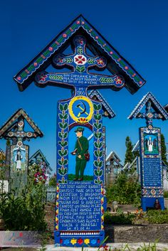 The unique Merry Cemetery from Maramures, a place which should be on your list for the next visit to Romania. It is here, each and every cross is painted in bright colors and describes in short epitaphs, sometimes funny, the life of the deceased one. Romania Bucharest, Visit Romania, Folk Art Flowers, A Level Art, Central Europe, Blue Aesthetic, Eastern Europe, Amazing Places, Cemetery