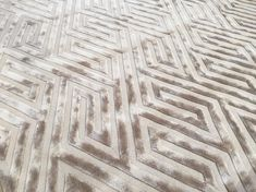 LABYRINTH - Crisp geometric design made in lustrous polished cotton; a showroom favourite that looks beautiful in both bright, bold colours as well as soft, subtle tones.  #Colbourns #handtuftedrugs #rug #carpet #handtufted #bespoke #madetoorder #geometric #labyrinth #interior #interiordesign #luxuryinteriors #luxuryhomes #luxurydesign #chelsea #140lotsroad