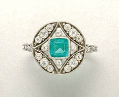 Emerald and diamond ring, circa 1915