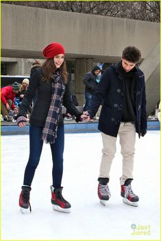 Bailee Madison falls into Rhys Matthew Bond's arms while ice skating at City Hall on Sunday afternoon (January 17) in Toronto, Canada.
