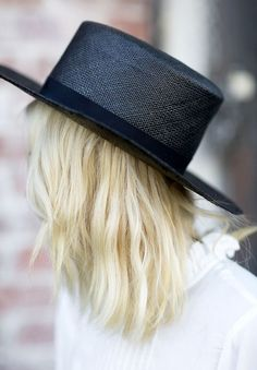Black straw hat to keep the sun out and your wardrobe cool.