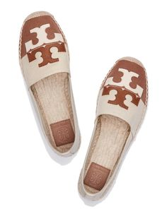A fresh take on a warm-weather favorite, our canvas Jamie Espadrille is chicly color-blocked, complete with a graphic double-T logo done in two tones of leather. It has a jute footbed, whipstitching a