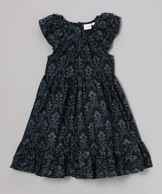 This fine Indian-made dress has ladies adorable in eclectic patterns swirling with color. Little ones will stay comfy as can be in the soft cotton construction while moving freely thanks to the roomy silhouette. Fluttery sleeves make it extra sweet.