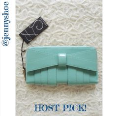 {z spoke zac posen} mint bow wallet Adorable new with tags mint patent leather bow wallet from Z spoke Zac posen.  Has a zipper and 12 credit card slots and 2 bill slots. Comes with a dust bag! Would make a perfect gift. Style name is 'Shirley' Zac Posen Bags Wallets