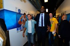 Steve Nash greets Dikembe Mutombo after the game of the Cleveland Cavaliers against the Golden State Warriors in Game One of the 2015 NBA Finals on...