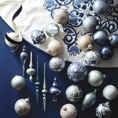 View Full Collection    A tribute to traditional blue-and-white ware, our exclusive French Blue and Linen Ornament Collection celebrates the season with crisp elegance. This    carefully curated collection of glass ornaments incorporates classic and contemporary designs, illustrated in tones of azure, twilight, sage, linen and    cream.                60-piece set; view all of the ornaments in this collection                    Matte, metallic and crackled finishes…