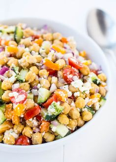 This healthy Chickpea Salad is loaded with fresh vegetables and then topped off with olive oil and salt. It's the perfect addition to any meal.