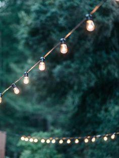 Outdoor wedding with globe lights. #lighting #atmosphere