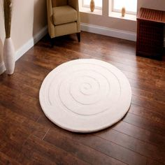 the BIG rug store Spiral Round Ivory Rug - A stunningly simple idea! We love the Spiral circular rugs. Here in off white ivory, a wonderful wool pile rug. And with free delivery within the UK mainland (see terms). Circular Rugs, Circle Rug, Jute Rug, Grey Rugs, Ivory Rugs, Round Rugs, Large Rugs, Carpet Runner, Modern Rugs