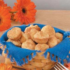 Mini Sour Cream Biscuits Recipe -These buttery mini muffins are flaky, tender and a snap to make because you start with convenient biscuit mix. Sara Dukes of Bartow, Georgia shared the recipe.