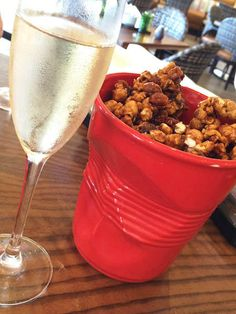 Popcorn & Pig (caramel #popcorn, #bacon, peanuts, fleur de sel) paired with #champagne - totally addictive!
