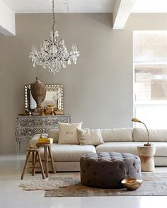 Natural sand tones for the walls. Like the contrast with the white ceiling and beams.