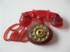 Adorable 1930's celluloid-Red telephone pin $44