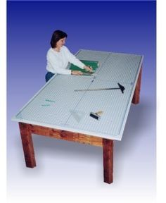4 ft x 6 ft Rhino Cutting Self Healing Table Mat.   Combine this with the Ikea hack to make a 4x6 cutting table with storage underneath.