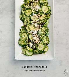 Raw zucchini carpaccio salad with basil-parsley vinaigrette, sun dried tomatoes, feta, pine nuts, and red pepper flakes.