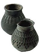 Lombard/Langobardic Cups To the left of the glass ceramic stamped Lombard (necropolis Gallo - end of the sixth century), on the right flask ceramic light gray stamped (Jewish Necropolis - end of the sixth century). Image taken from Menis GC, Lombard Italy, Venice, 1991 http://archeologiamedievale.unisi.it/SitoCNR/Ceramica/AM/AM104h.html