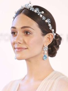 <p>Heading to a fancy event? Pair a sleek, low braided bun with a sparkly headpiece like Shameless a... - Getty Images Entertainment