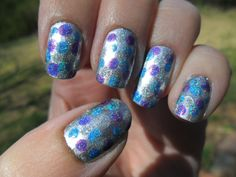 Cute and Shiny- Sally Hansen Silver Sweep, dotted with Color Club Over the Moon, Eternal Beauty, and Magic Attraction.