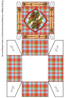 "A tartan gift box with holly and banners around the sides saying ""Compliments of the Season""."