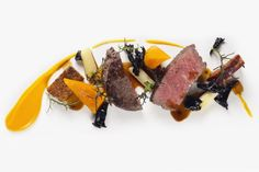 Fillet of Beef with PumkinYuzu Puree, Butter Braised Leeks, Trompette de la Mort, Bacon Pudding and Madeira Jus - The ChefsTalk Project