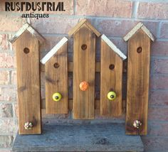 Weathered birdhouse wall rack made using reclaimed wood with ceramic drawer knobs. Rustdustrial Antiques and Home Decor Blessed Sign, Wall Racks, Drawer Knobs, Hobby, Rustic Industrial, Birdhouses, Repurposed, Fairy, Ceramics