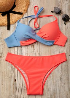 651b1a5a8a Twist Front Halter Color Block Bikini Set for summer beach and pool season.  Red and blue color bikini with a knot.