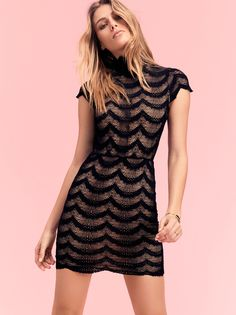 Fiesta Fan District Mini Dress | Sheer lace bodycon mini dress featuring a mock neck and short sleeves.    * Scalloped trims.   * Partially lined.   * Stretchy fabrication.   * Pull-on silhouette.
