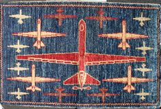 Dark Blue Reaper Drone War Rug with Traditional Turkmen Border This rug received by warrug.com directly from the weavers in Pakistan.