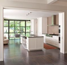 Crestbrook Kitchen Hidden Pocket Doors | See more custom projects from Tatum Brown Custom Homes at www.tatumbrown.com