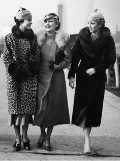 1930s-1940s: Woman in the middle is wearing a clutch coat. There are no fastenings.