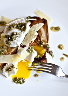 poached eggs on challah bread with pecorino and pesto