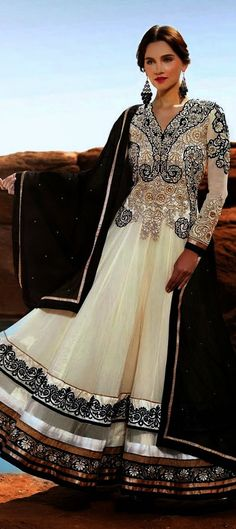 409370: Beige and Brown color family unstitched Anarkali Suits.