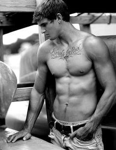 Hot guy with even hotter tatt
