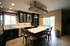 Kitchen Soffit / Reclaimed West hand-crafted reclaimed wood soffit made with holes for drop lighting and metal components / Colorado / TVL Creative