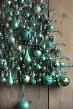 Ornaments hung on panel of wood in shape of a Christmas tree Aqua Christmas, Christmas Tree Toppers, Christmas Colors, Xmas Tree, All Things Christmas, Christmas Themes, Christmas Crafts, Christmas Decorations, Christmas Ornaments