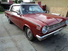 '65 Rambler American in Garden Grove. love the red interior with the white stripes!