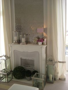 silver tiles: statement piece. maybe hang some framed artwork over them to add layers?