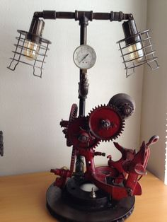 Steam Punk Industrial Lamp...Built in our shop, we're so happy we were able to save a fantastic farm piece.  EliteRust.com