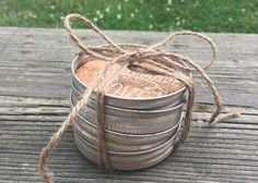 This set of 4 Mason Jar lid Coasters will give your table a rustic farmhouse look and feel. Its made with original Ball Mason Jar lids, Hand cut Cork sheet, Hand stamped and distressed with chalk paint. Each coaster measures 2 3/8 inch inner diameter(60mm) and 2 3/4 inch outer
