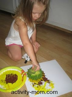 Easy Activities for Your 2 Year Old (Shown: Painting with Flowers)
