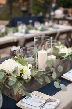 Centre piece idea instead of full greenery. Rustic wooden boxes on a white table runner would look nice