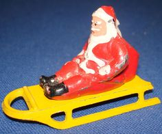 Vintage Christmas Collectible ~ Sledding Santa Claus with Sack of Toys