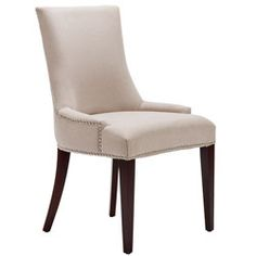 Becca Chair will work well with a wide range of dining styles  This pre-assembled chair is made with a full solid frame for support and solid sturdy seating  Furniture showcases soft beige 100-percent linen fabric