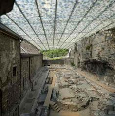 A 1500-year-old abbey constantly threatened by stones falling from an abutting cliffside is now protected by a beautiful, modern suspended roof.