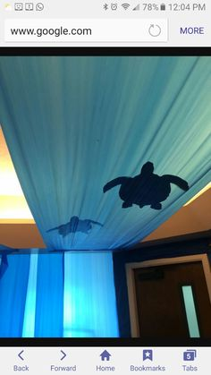 Cardboard sea turtles and blue table cloth (thin fabric or plastic)