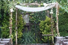 This is my birch arbor lightly decorated with an antique lace cover, which was a family heirloom of the brides.