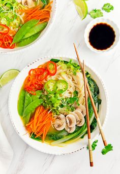 Vegan Pho soup!  So amazingly delicious, healthy and a lot easier to make than you would think. Pho is comfort food at its finest, packed with fresh, healthy ingredients and tasty rice noodles.  Nothing beats a steaming hot bowl of pho!