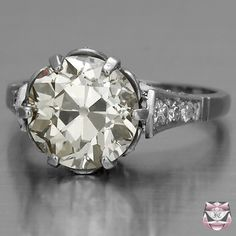 Certified 4.00ct European-cut Diamond Engagement Ring  Like sides and the hold on the ring. Also like the way it looks straight on